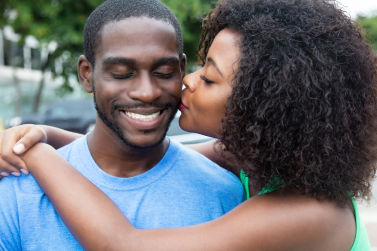 Kissing african american couple